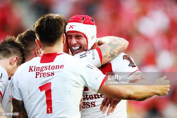 Chris Hill celebrates with Gareth Widdop of England during the 2017 Rugby League World Cup Semi Final match between Tonga and England at Mt Smart...