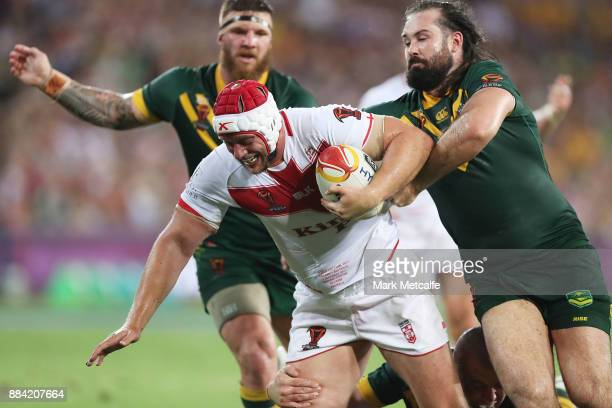 Chris Hill of England is tackled by Aaron Woods of Australia during the 2017 Rugby League World Cup Final between the Australian Kangaroos and...