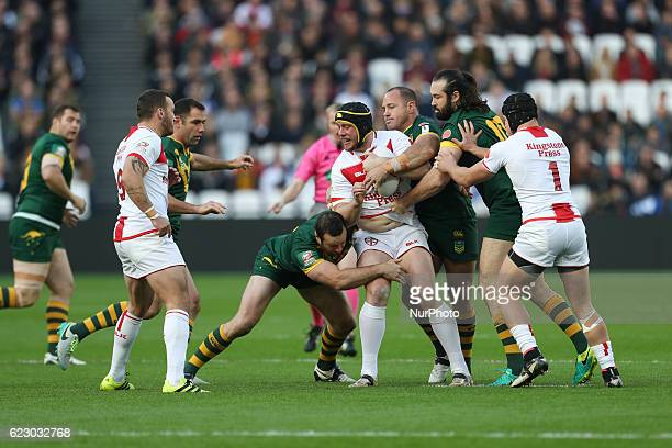 Chris Hill of England is tackled by Matthew Scott Aaron Woods Boyd Corner of Australia during the Four Nations between England against Australia at...