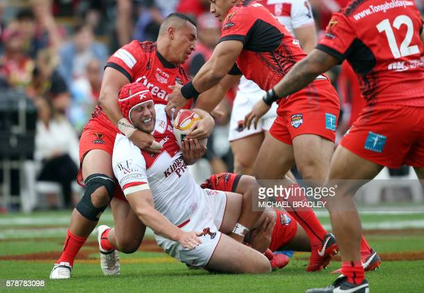 Chris Hill of England is tackled by the Tongan defence during the Rugby League World Cup men's semifinal match between Tonga and England at Mt Smart...