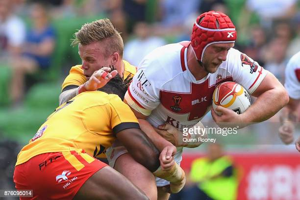 Chris Hill of England is tackled during the 2017 Rugby League World Cup Quarter Final match between England and Papua New Guinea Kumuls at AAMI Park...