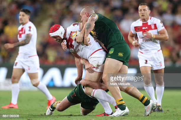 Chris Hill of England is tackled during the 2017 Rugby League World Cup Final between the Australian Kangaroos and England at Suncorp Stadium on...