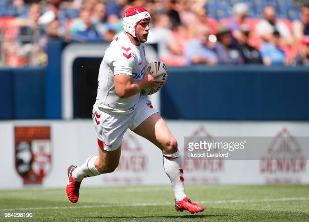 Chris Hill of England runs the ball back during the second half of a Rugby League Test Match between England and the New Zealand Kiwis at Sports...