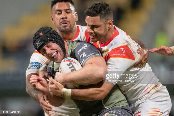 Chris Hill of Warrington Wolves is tackled by the Catalans defence during the Catalans Dragons V Warrington Wolves Betfred Super League regular...