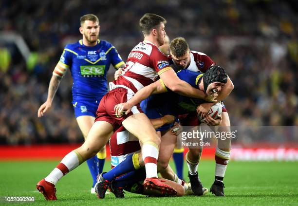 Chris Hill of Warrington Wolves is tackled during the BetFred Super League Grand Final between Warrington Wolves and Wigan Warriors at Old Trafford...