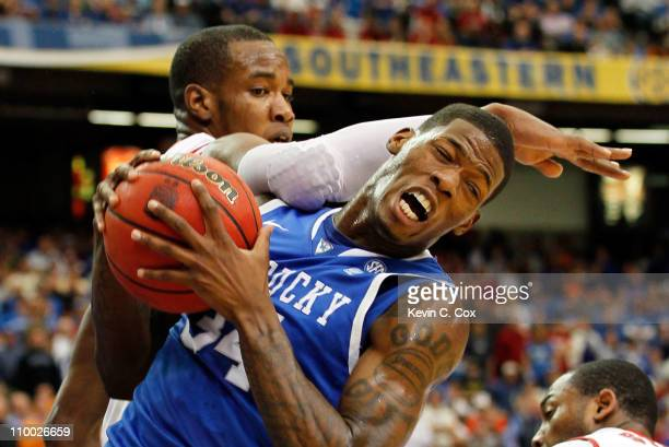 Chris Hines of the Alabama Crimson Tide comes down on DeAndre Liggins of the Kentucky Wildcats as he grabs a rebound during the semifinals of the SEC...