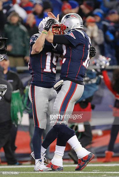 Chris Hogan celebrates with Tom Brady of the New England Patriots after making a 34yard touchdown reception during the second quarter against the...