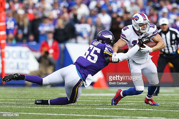 Chris Hogan of the Buffalo Bills makes a catch as Anthony Barr of the Minnesota Vikings defends during the second half at Ralph Wilson Stadium on...