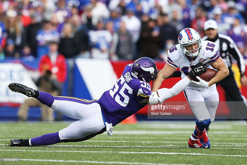 Chris Hogan #15 of the Buffalo Bills makes a catch as Anthony Barr #55 of the Minnesota Vikings defends during the second half at Ralph Wilson Stadium on October 19, 2014 in Orchard Park, New York.