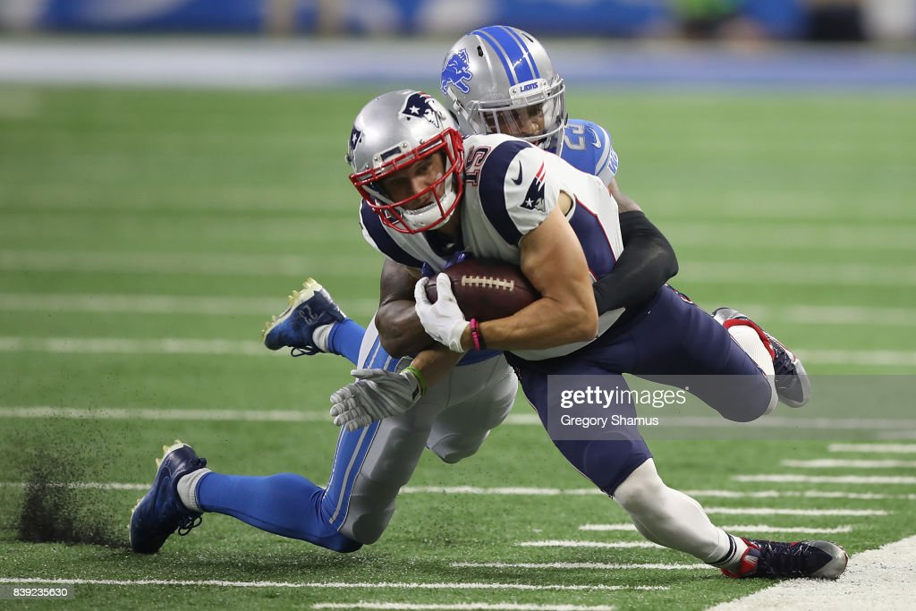 Chris Hogan #15 of the New England Patriots battles for extra yards after a first quarter catch while being tackled by Darius Slay #23 of the Detroit Lions during a preseason game at Ford Field on August 25, 2017 in Detroit, Michigan.