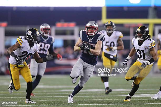 Chris Hogan of the New England Patriots carries the ball against the Pittsburgh Steelers during the third quarter in the AFC Championship Game at...