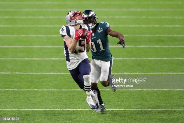 Chris Hogan of the New England Patriots catches a 43yard reception past Jalen Mills of the Philadelphia Eagles during the second quarter in Super...