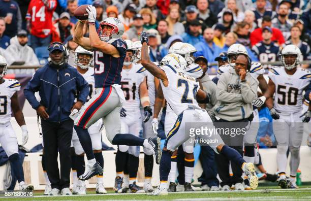 Chris Hogan of the New England Patriots catches a pass as he is defended by Trevor Williams of the Los Angeles Chargers during the third quarter of a...