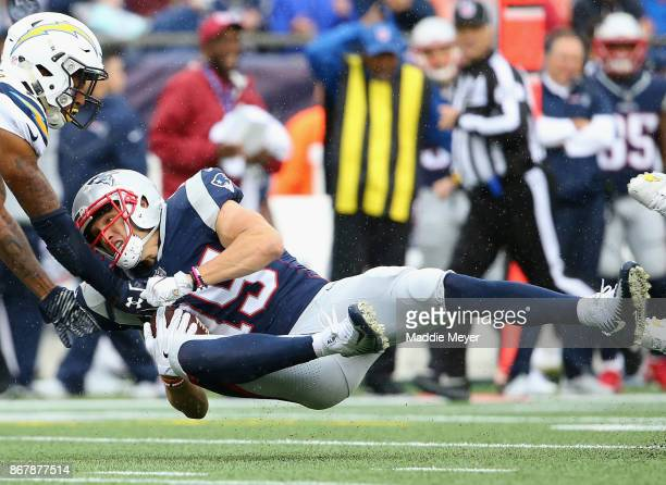 Chris Hogan of the New England Patriots catches a pass during the third quarter of a game against the Los Angeles Chargers at Gillette Stadium on...