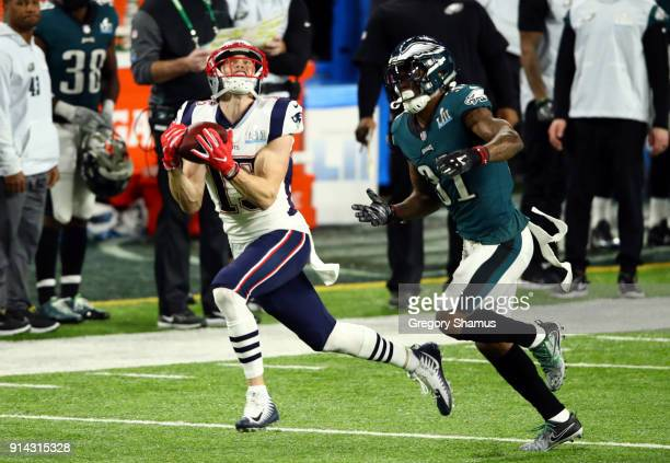 Chris Hogan of the New England Patriots catches a pass for 43 yards against Jalen Mills of the Philadelphia Eagles during the second quarter in Super...