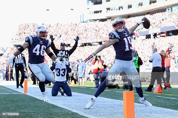 Chris Hogan of the New England Patriots celebrates scoring a touchdown during the second quarter against the Los Angeles Rams at Gillette Stadium on...