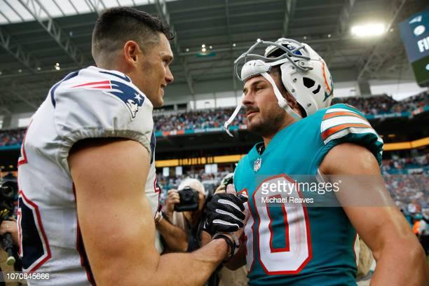 Chris Hogan of the New England Patriots congratulating Danny Amendola of the Miami Dolphins after the Miami Dolphins defeat the New England Patriots...