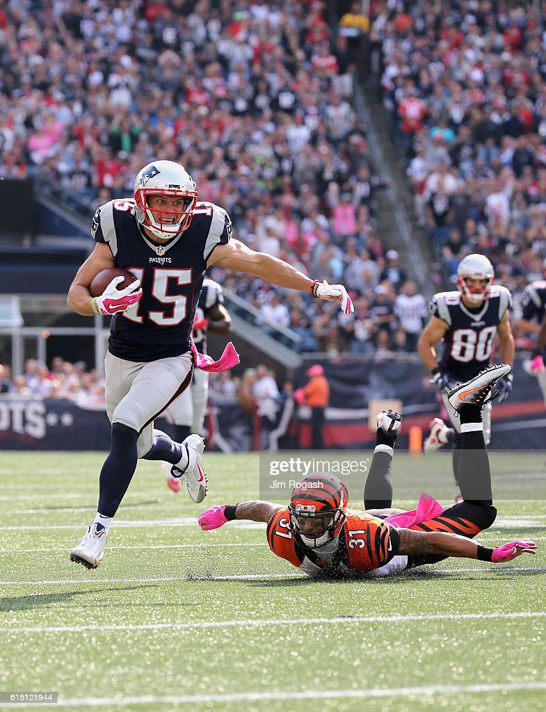 Chris Hogan #15 of the New England Patriots evades the tackle of Derron Smith #31 of the Cincinnati Bengals during the game at Gillette Stadium on October 16, 2016 in Foxboro, Massachusetts.