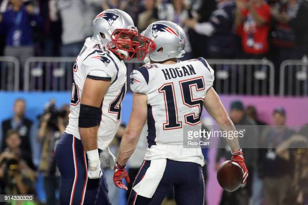 Chris Hogan of the New England Patriots is congratulated by his teammate David Harris after his 26yard touchdown reception during the third quarter...