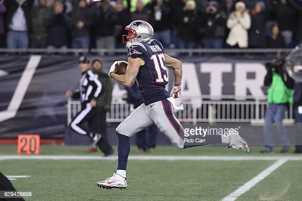 Chris Hogan of the New England Patriots runs on his way to scoring a 79yard touchdown during the fourth quarter against the Baltimore Ravens at...