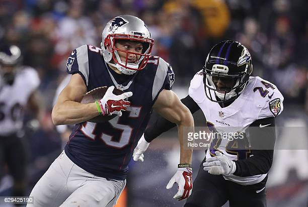 Chris Hogan of the New England Patriots runs with the ball against Shareece Wright of the Baltimore Ravens during the second half of their game at...