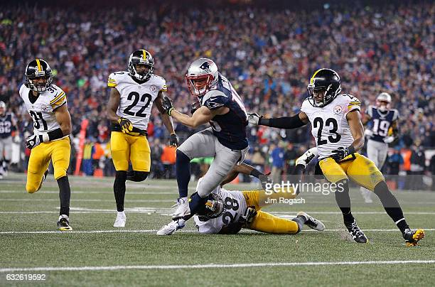 Chris Hogan of the New England Patriots runs with the ball against the Pittsburgh Steelers in the AFC Championship Game at Gillette Stadium on...