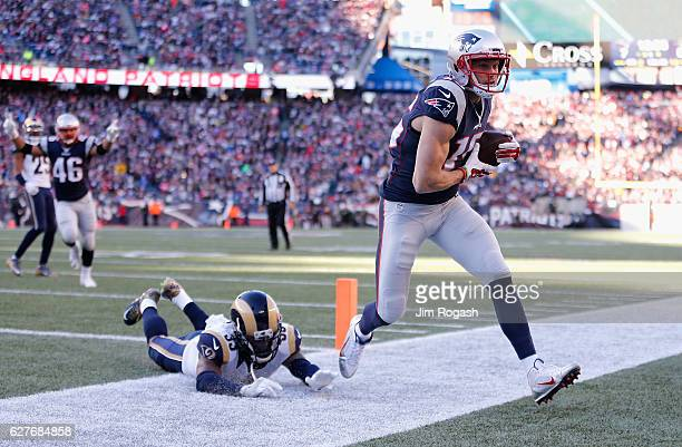 Chris Hogan of the New England Patriots scores a touchdown during the second quarter against the Los Angeles Rams at Gillette Stadium on December 4...