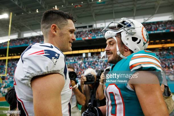 Chris Hogan of the New England Patriots talks with Danny Amendola of the Miami Dolphins after the game at Hard Rock Stadium on December 9 2018 in...