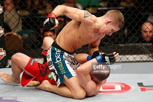 Chris Holdsworth punches Chico Camus in their bantamweight bout during the UFC 173 event at the MGM Grand Garden Arena on May 24 2014 in Las Vegas...