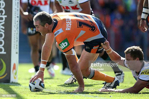 Chris Houston of the Knights scores a try during the round four NRL match between the Newcastle Knights and the Penrith Panthers at Hunter Stadium on...