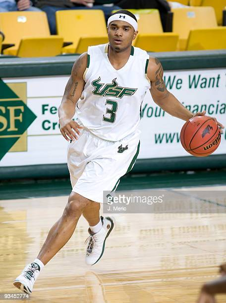 Chris Howard of the South Florida Bulls brings the ball up the court against the Florida Atlantic Owls during the game at the SunDome on November 27...