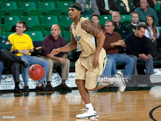 Chris Howard of the South Florida Bulls brings the ball up the court against the Notre Dame Fighting Irish during the game at the SunDome on January...