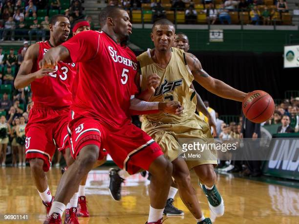 Chris Howard of the South Florida Bulls drives as Sean Evans of the St John's Red Storm defends during the game at the SunDome on February 20 2010 in...