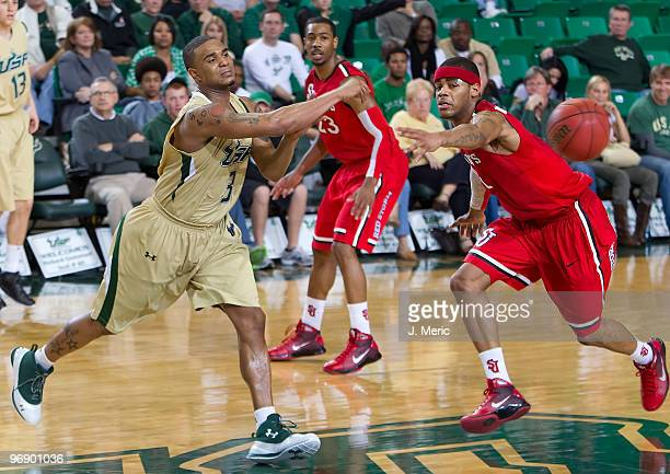 Chris Howard of the South Florida Bulls passes the ball as DJ Kennedy of the St John's Red Storm defends during the game at the SunDome on February...