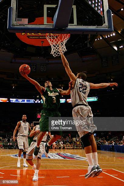 Chris Howard of the USF Bulls goes to the hoop against Julian Vaughn of the Georgetown Hoyas during the second round of 2010 NCAA Big East Tournament...