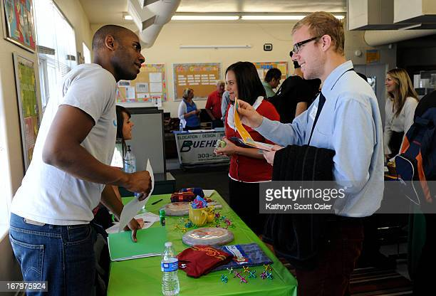 Chris Howell right gets information from Kenny Moten a human resources and training official at Snooze restaurant as Urban Peak a nonprofit...