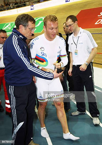 Chris Hoy of Great Britain and SKYHD Team is helped to his feet after crashing out of the final of the Keirin during day two of the UCI Track World...