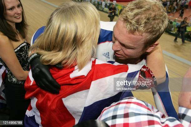 Chris Hoy of Great Britain celebrates with his fMother Carol after winning the gold medal Men's Individual Sprint Final in the track cycling event at...