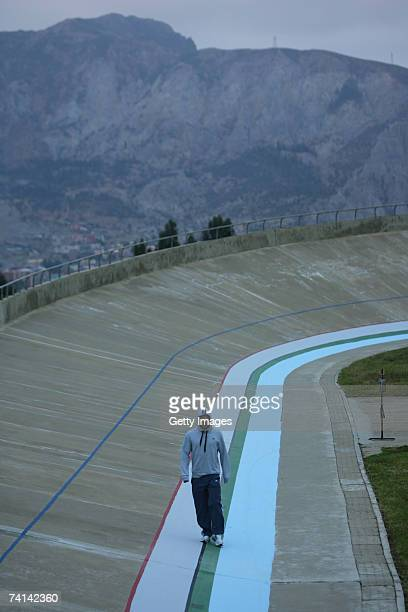 Chris Hoy of Great Britain cuts a lonely figure as he walks around the velodrome early morning in preparations before his failed attempt to break the...