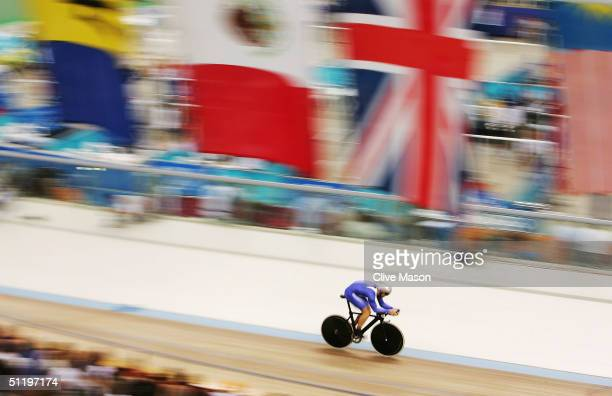 Chris Hoy of Great Britain in action on his way to setting a new Olympic record and winning the men's track cycling 1 kilometre time trial final on...