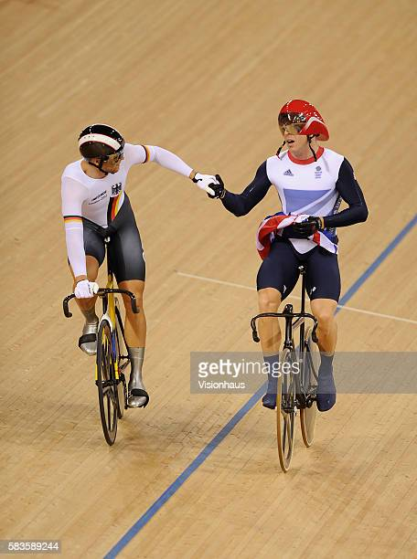 Chris Hoy of Great Britain is congratulated by silver medalist Maximilian Levy of Germany after Hoy won the Mens Keirin during the Track Cycling as...