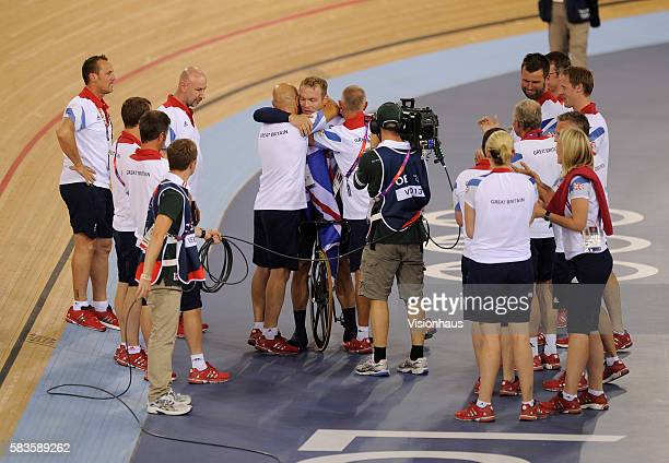 Chris Hoy of Great Britain is congratulated by team coach Dave Brailsford after winning the Mens Keirin during the Track Cycling as part of the 2012...