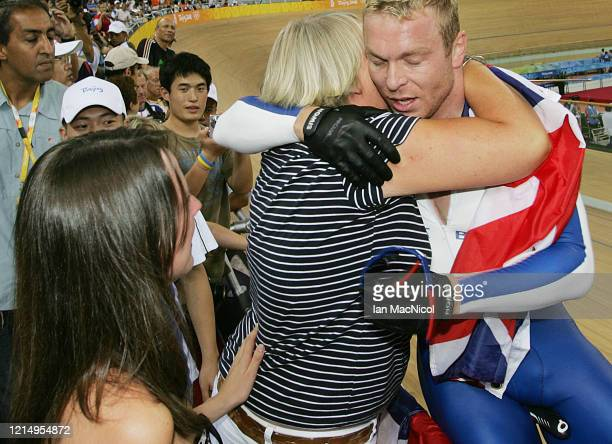 Chris Hoy of Great Britain is seen with his mother Carol after winning gold in the individual sprint during The Beijing Olympic Games on August 19...