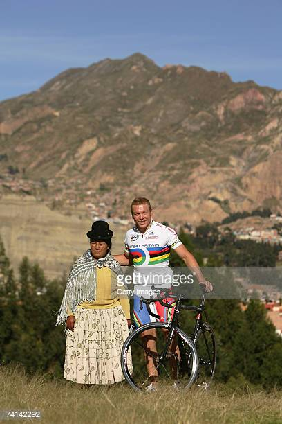 Chris Hoy of Great Britain poses with a local woman after breaking the World 500 Metre Altitude Record at the Alto Irpavi Velodrome May 13 2007 in La...