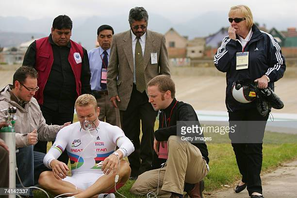 Chris Hoy of Great Britain takes on oxygen assisted by Doctor Kenneth Baillie as his mother Carol Hoy nervously looks on after his failed attempt to...