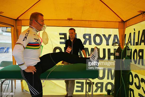 Chris Hoy of Great Britain watched by Doctor Kenneth Bailliestretches in preparations before his failed attempt to break the World 1 Kilometre...