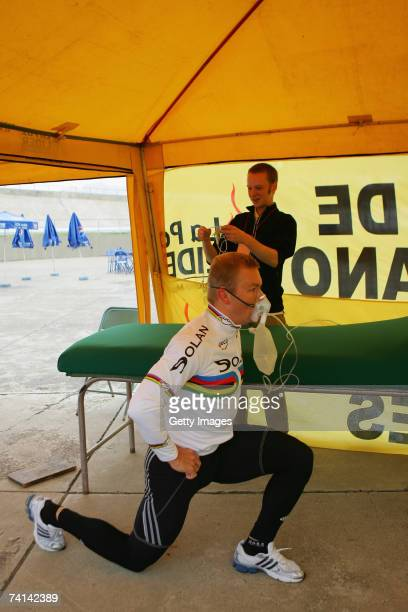 Chris Hoy of Great Britain, watched by Doctor Kenneth Baillie,stretches in preparations before his failed attempt to break the World 1 Kilometre...