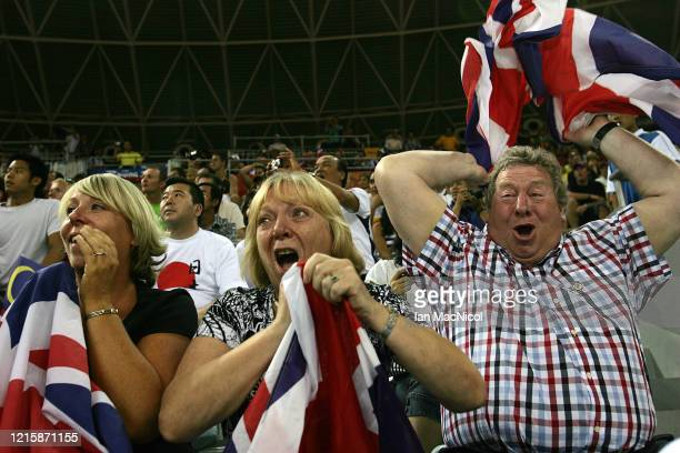 Chris Hoy's parents David and Carol celebrate after he wins gold in the Keirin Final held at the Laoshan Velodrome during Day 9 of the 2008 Beijing...
