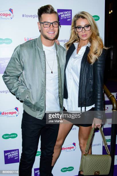 Chris Hughes and Olivia Attwood during a photocall for Specsaver's Spectacle Wearer Of The Year at 8 Northumberland Avenue on October 10 2017 in...