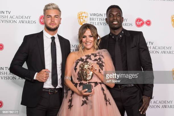 Chris Hughes Caroline Flack and Marcel Somerville pose with the award for Best Reality and Constructed Factual Series for 'Love Island' in the press...